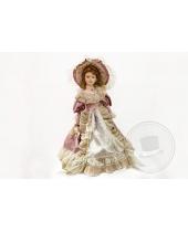 Bambola di porcellana con abito ottocentesco