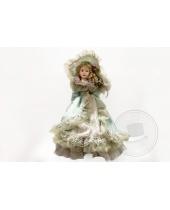 Bambola di porcellana con abito in pizzo